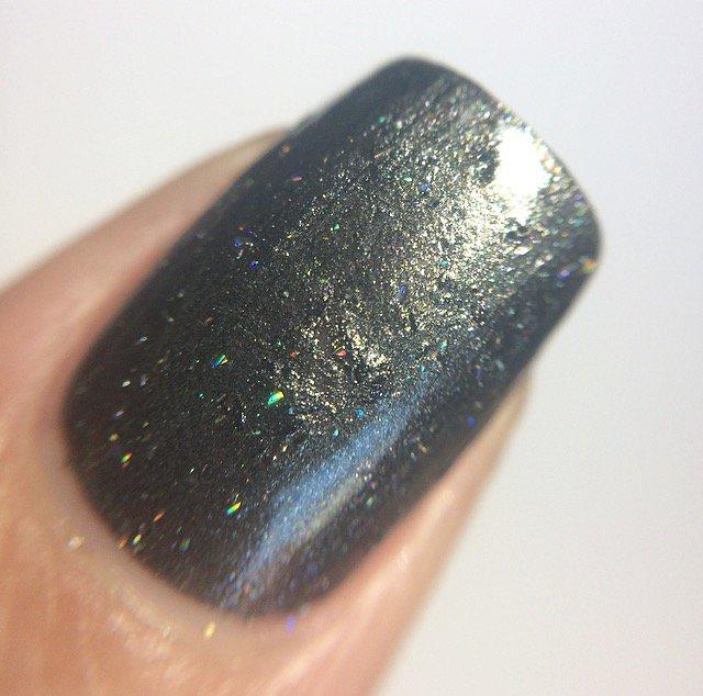 close up of nail with gunmetal grey nail polish