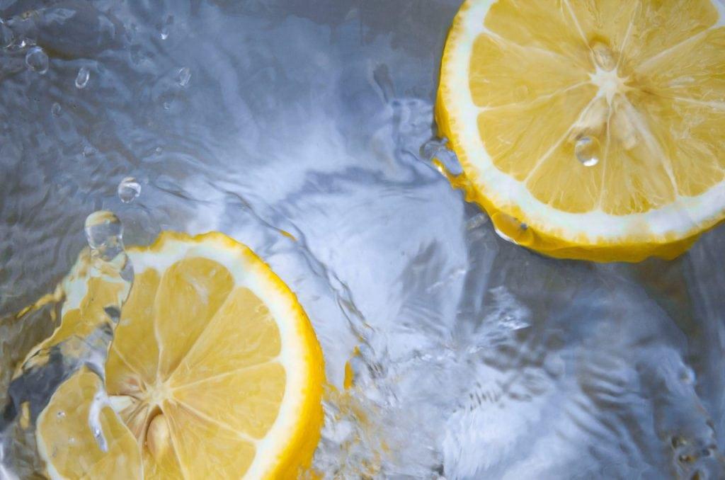 two lemon halves floating in water