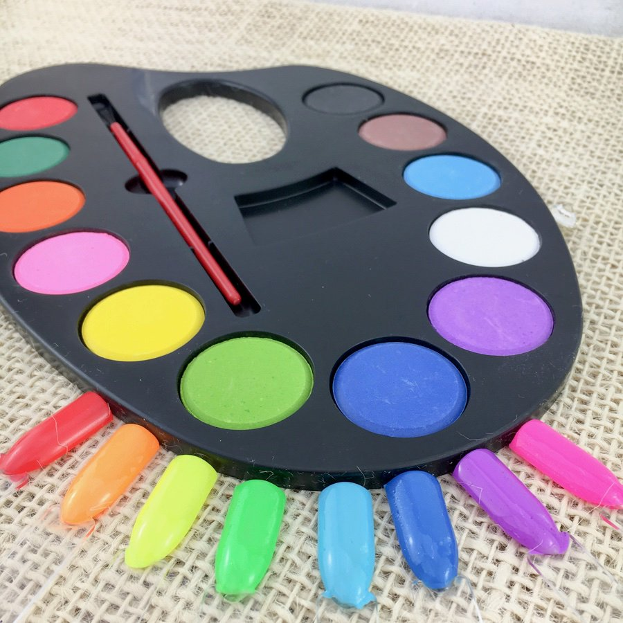 Bright coloured paint easel with matching coloured popsticks