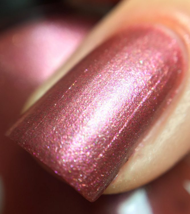 Close up female fingernail with LivOliv 'Wine Me Dine Me' vegan nail polish