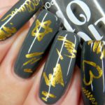 Charlotte - A charcoal grey nail polish with gold nail art