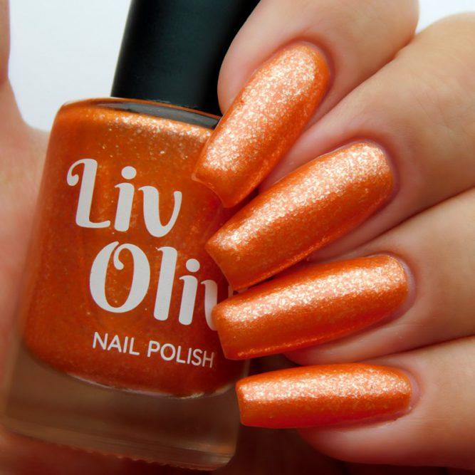 Closeup of nails painted in Coral orange nail polish